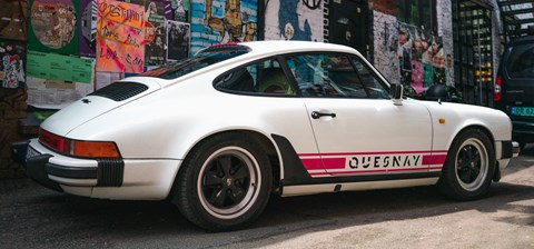 Porsche car with Quesnay logo